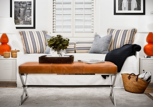 white-window-seat-tan-leather-stainless-ottoman-bench-tangerine-ceramic-table-lamps-white-fireplace-black-and-white-prints-white-rug-stripe-cushions-diane-bergeron